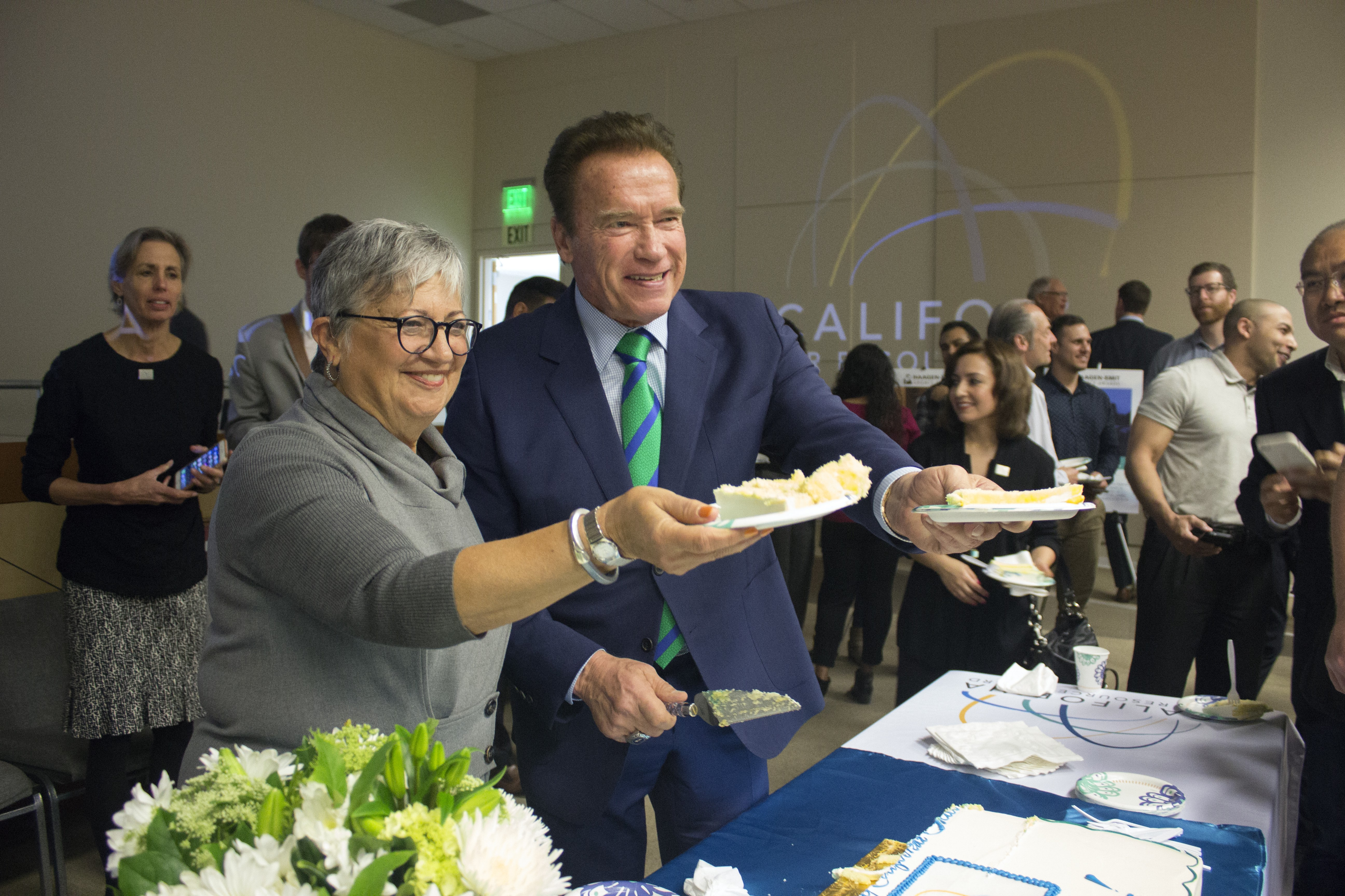 Chair Nichols & former Governor Schwarzenegger hand out cake for 50th Anniversary Celebration
