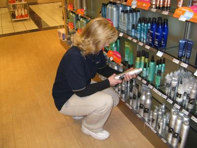 woman inspecting product on store shelf