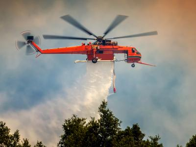 Helicopter batteling wildfire